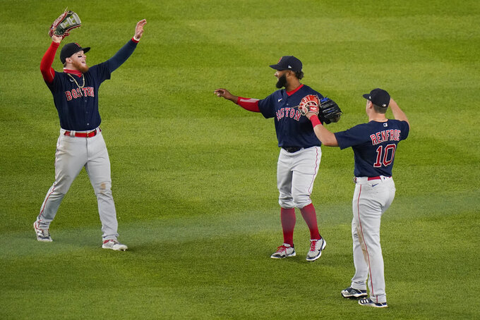 Boston Red Sox's Alex Verdugo, left, Danny Santana, center, and Hunter Renfroe celebrate after a baseball game against the New York Yankees, Friday, June 4, 2021, in New York. (AP Photo/Frank Franklin II)