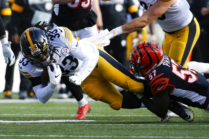 Pittsburgh Steelers running back Trey Edmunds (33) is tackled by Cincinnati Bengals linebacker Germaine Pratt (57) during the first half an NFL football game, Sunday, Nov. 24, 2019, in Cincinnati. (AP Photo/Frank Victores)