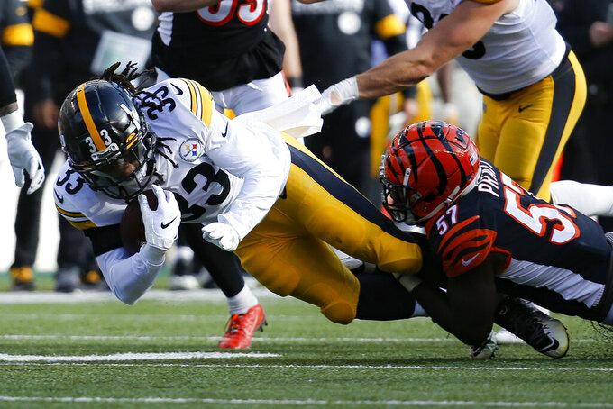 Pittsburgh Steelers running back Trey Edmunds (33) is tackled by Cincinnati Bengals linebacker Germaine Pratt (57) during the first half an NFL football game, Sunday, Nov. 24, 2019, in Cincinnati. (AP Photo/Frank Victores)