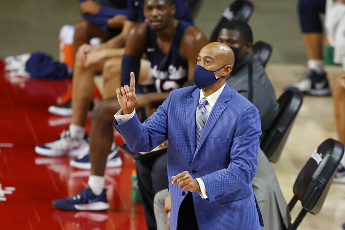 Jackson State head coach Wayne Brent directs his team against Iowa State during the first half of an NCAA college basketball game, Sunday, Dec. 20, 2020, in Ames, Iowa. (AP Photo/Matthew Putney)