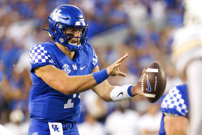 Kentucky quarterback Will Levis (7) takes the snap during the first half of an NCAA college football game against Missouri in Lexington, Ky., Saturday, Sept. 11, 2021. (AP Photo/Michael Clubb)