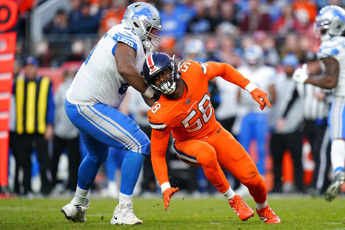 Denver Broncos outside linebacker Von Miller (58) spins arounds Detroit Lions offensive tackle Tyrell Crosby during the second half of an NFL football game, Sunday, Dec. 22, 2019, in Denver. (AP Photo/Jack Dempsey)