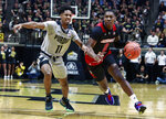 Jacksonville State guard Derrick Cook (0) drives around Purdue guard Isaiah Thompson during an NCAA college basketball game Saturday, Nov. 23, 2019, in West Lafayette, Ind. (AP Photo/R Brent Smith)