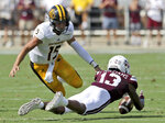 Mississippi State cornerback Tyler Williams (13) recovers a Southern Mississippi quarterback Jack Abraham (15) fumble in the first half of an NCAA college football game Saturday, Sept. 7, 2019, in Starkville, Miss. (AP Photo/Jim Lytle)