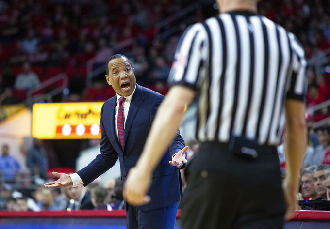 North Carolina State coach Kevin Keatts argues with an official during the first half of the team's NCAA college basketball game against Loyola of Maryland in Raleigh, N.C., Friday, Dec. 28, 2018. (AP Photo/Ben McKeown)