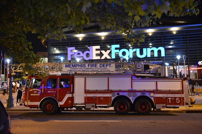 A fire truck is parked outside FedExForum after a fire alarm went off during an NBA preseason basketball game between the Milwaukee Bucks and the Memphis Grizzlies Tuesday, Oct. 5, 2021, in Memphis, Tenn. (AP Photo/Brandon Dill)