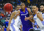 Abilene Christian's Jaren Lewis (1) goes after a loose ball, next to Kentucky's Keldon Johnson (3) and Jemarl Baker Jr., right, during the first half of a first-round game in the NCAA men's college basketball tournament in Jacksonville, Fla., Thursday, March 21, 2019. (AP Photo/Stephen B. Morton)