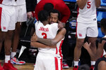 Houston guard DeJon Jarreau (3) hugs Justin Gorham (4) during the second half of an Elite 8 game against Oregon State in the NCAA men's college basketball tournament at Lucas Oil Stadium, Monday, March 29, 2021, in Indianapolis. Houston won 67-61. (AP Photo/Michael Conroy)