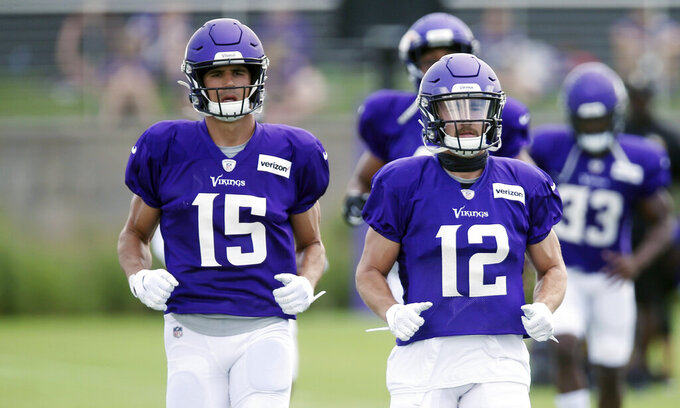 Minnesota Vikings wide receivers Brandon Zylstra, left, and Chad Beebe run during calisthenics at the NFL football team's training camp Monday, July 29, 2019, in Eagan, Minn. (AP Photo/Jim Mone)