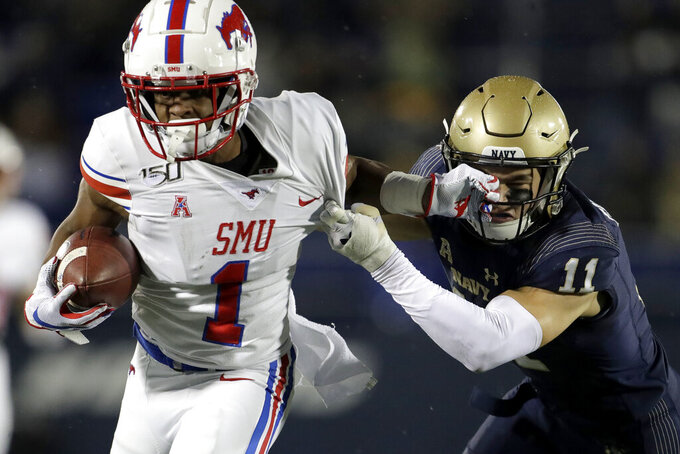 SMU wide receiver CJ Sanders (1) runs with the ball as Navy safety Evan Fochtman (11) tries to bring him down during the first half of an NCAA college football game, Saturday, Nov. 23, 2019, in Annapolis, Md. (AP Photo/Julio Cortez)