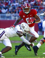 Alabama running back Josh Jacobs (8) is tackled by Mississippi State defensive end Montez Sweat (9) as he carries the ball during the first half of an NCAA college football game, Saturday, Nov. 10, 2018, in Tuscaloosa, Ala. (AP Photo/Butch Dill)