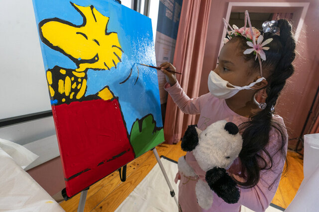 Kaley Williams, 8, paints a panel of a