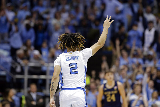 North Carolina guard Cole Anthony (2) reacts following a 3-point basket during the second half of an NCAA college basketball game against the Notre Dame in Chapel Hill, N.C., Wednesday, Nov. 6, 2019. North Carolina won 76-65. (AP Photo/Gerry Broome)