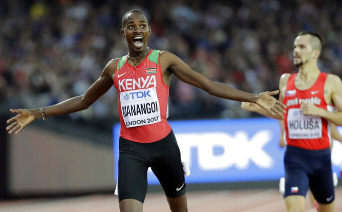 """FILE - In this Sunday, Aug. 13, 2017 file photo, Kenya's Elijah Manangoi celebrates winning the gold medal in the Men's 1500m final during the World Athletics Championships in London. Former 1,500-meter world champion Elijah Manangoi was provisionally suspended Thursday, July 23, 2020 for missing doping tests. The Athletics Integrity Unit said the Kenyan runner has been charged with """"whereabouts failures."""" No timetable for his disciplinary case was given. (AP Photo/David J. Phillip, File)"""