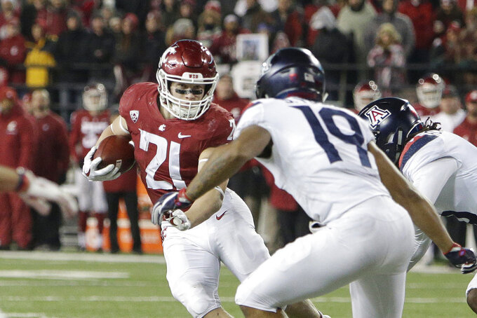 Washington State running back Max Borghi (21) runs with the ball while pursued by Arizona safety Scottie Young Jr. (19) during the second half of an NCAA college football game in Pullman, Wash., Saturday, Nov. 17, 2018. Washington State won 69-28. (AP Photo/Young Kwak)