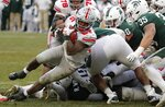 Ohio State running back Mike Weber (25) falls into the end zone for a 2-yard rushing touchdown during the second half of an NCAA college football game against the Michigan State, Saturday, Nov. 10, 2018, in East Lansing, Mich. (AP Photo/Carlos Osorio)