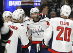 Washington Capitals' Brett Connolly, center (10), celebrates his goal with teammates during the first period of an NHL hockey game against the Los Angeles Kings Monday, Feb. 18, 2019, in Los Angeles. (AP Photo/Marcio Jose Sanchez)