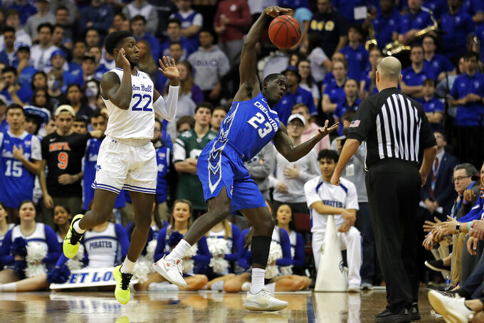 Creighton forward Damien Jefferson (23) steals the ball from Seton Hall guard Myles Cale (22) during the first half of an NCAA college basketball game Wednesday, Feb. 12, 2020, in Newark, N.J. (AP Photo/Adam Hunger)