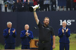 Ireland's Shane Lowry smiles as he holds the Claret Jug trophy aloft after being presented with it for winning the British Open Golf Championships at Royal Portrush in Northern Ireland, Sunday, July 21, 2019.(AP Photo/Jon Super)