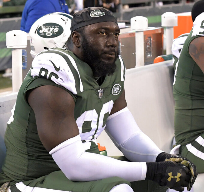 FILE - In this Nov. 26, 2017, file photo, New York Jets defensive end Muhammad Wilkerson sits on the bench during the second half of an NFL football game against the Carolina Panthers, in East Rutherford, N.J. Former New York Jets defensive end Wilkerson is charged with driving while intoxicated after his arrest in New York City. A police spokesman says Wilkerson was arraigned Saturday, June 1, 2019,  in Manhattan Criminal Court and released on his own recognizance. (AP Photo/Bill Kostroun, File)