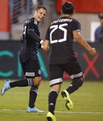 Mexico forward Javier Hernandez, left, celebrates with midfielder Erick Gutierrez after Gutierrez scored a goal against the United States during the second half of an international friendly soccer match Friday, Sept. 6, 2019, in East Rutherford, N.J. Mexico won 3-0. (AP Photo/Kathy Willens)
