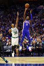 Philadelphia 76ers' Josh Richardson, right, shoots the ball with Boston Celtics' Marcus Smart, left, defending during the first half of an NBA basketball game Wednesday, Oct. 23, 2019, in Philadelphia. (AP Photo/Chris Szagola)