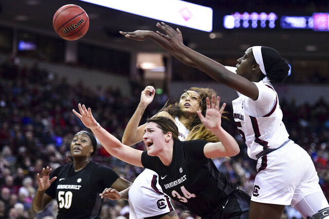 Vanderbilt forward Mariella Fasoula (34) is fouled attempting a shot against South Carolina forward Laeticia Amihere, right, and Mikiah Herbert Harrigan, left, during the first half of an NCAA college basketball game Monday, Feb. 17, 2020, in Columbia, S.C. (AP Photo/Sean Rayford)