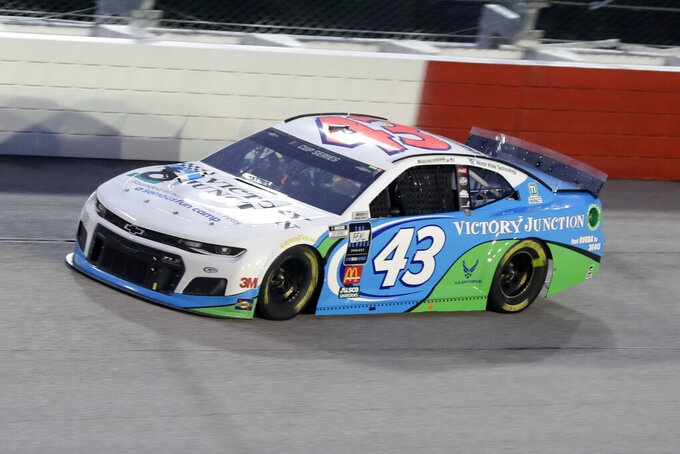 Bubba Wallace (43) drives during the NASCAR Cup Series auto race Wednesday, May 20, 2020, in Darlington, S.C. (AP Photo/Brynn Anderson)
