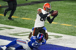 Cleveland Browns' Jarvis Landry (80) catches a pass for a touchdown as New York Giants' Isaac Yiadom (27) defends during the first half of an NFL football game Sunday, Dec. 20, 2020, in East Rutherford, N.J. (AP Photo/Corey Sipkin)