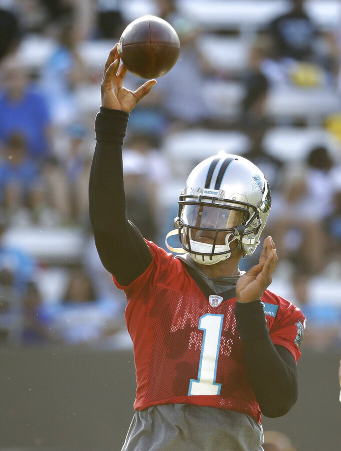 Carolina Panthers quarterback Cam Newton throws a pass during practice at the NFL football team's training camp in Spartanburg, N.C., Thursday, July 25, 2019. (AP Photo/Chuck Burton)