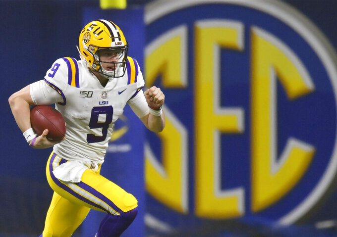 FILE - In this Dec. 7, 2019, file photo, LSU quarterback Joe Burrow (9) runs against Georgia during the second half of the Southeastern Conference championship NCAA college football game, in Atlanta. The Southeastern Conference broke the NFL record for first-round draft picks by a conference. Fifteen players from the powerhouse league were selected in the opening round Thursday night, April 23, 2020. (AP Photo/Mike Stewart, File)