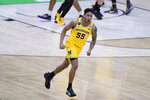 Michigan guard Eli Brooks celebrates after making a 3-point basket during the second half of a second-round game against LSU in the NCAA men's college basketball tournament at Lucas Oil Stadium Monday, March 22, 2021, in Indianapolis. (AP Photo/Darron Cummings)