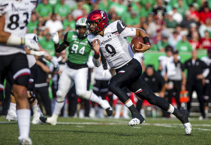 Cincinnati quarterback Desmond Ridder (9) speeds up field on a keeper as the Bearcats take on Marshall an NCAA college football game on Saturday, Sept. 28, 2019, in Huntington, W.Va. (Sholten Singer/The Herald-Dispatch via AP)