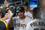Pittsburgh Pirates' Yoshi Tsutsugo, center is greeted by teammates in the dugout after hitting a solo home run against the Arizona Diamondbacks in the seventh inning of a baseball game against the Arizona Diamondbacks, Monday, Aug. 23, 2021, in Pittsburgh. (AP Photo/Keith Srakocic)