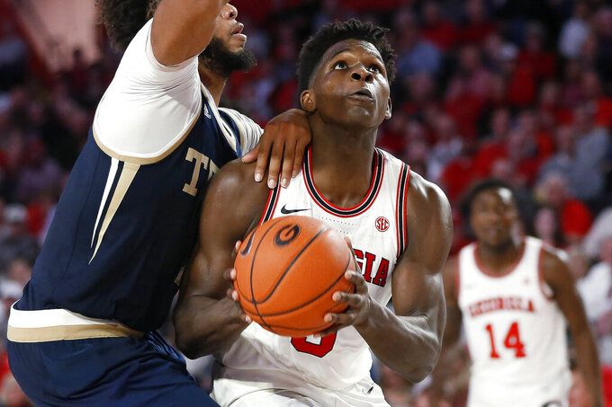 Georgia's Anthony Edwards (5) looks to shoot while being defended by Georgia Tech forward James Banks III (1) during an NCAA college basketball game Wednesday, Nov. 20, 2019, in Athens, Ga. (Joshua L. Jones/Athens Banner-Herald via AP)