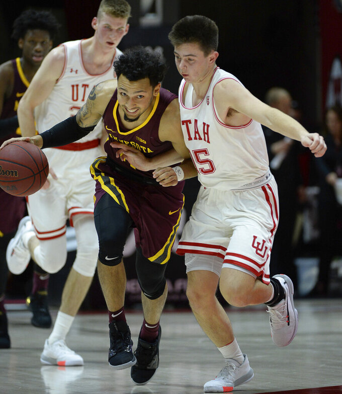 Minnesota guard Payton Willis (0) pushes past Utah guard Rylan Jones, right, during an NCAA college basketball game Friday, Nov. 15, 2019, in Salt Lake City. (Francisco Kjolseth/The Salt Lake Tribune via AP)