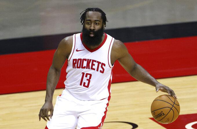 Houston Rockets' James Harden controls the ball during the first half of an NBA basketball game against the San Antonio Spurs in Houston, Thursday, Dec. 17, 2020. (Carmen Mandato/Pool Photo via AP)
