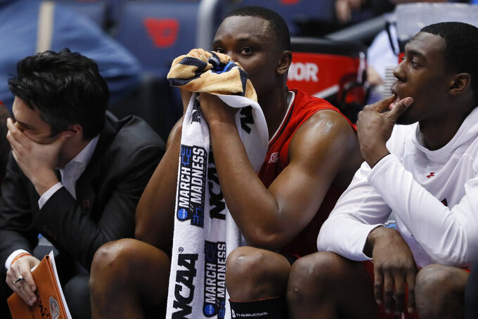 St. John's Mustapha Heron, center, sits on the bench after fouling out during the second half against Arizona in a First Four game of the NCAA mens college basketball tournament Wednesday, March 20, 2019, in Dayton, Ohio. (AP Photo/John Minchillo)