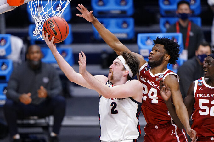 Gonzaga forward Drew Timme (2) shoots under Oklahoma guard Elijah Harkless (24) in the second half of a college basketball game in the second round of the NCAA tournament at Hinkle Fieldhouse in Indianapolis, Monday, March 22, 2021. (AP Photo/AJ Mast)