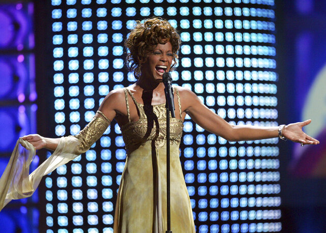 "FILE - In this Sept. 15, 2004 file photo, recording artist Whitney Houston performs at the 2004 World Music Awards at the Thomas and Mack Arena in Las Vegas. Houston is about to appear on the concert stage again. Eight years after her death, five years after the show was conceived and a year after production began, a holographic Houston will embark on a European tour starting Feb. 25, with U.S. dates expected to follow. The singer's sister-in-law and former manager Pat Houston says it's the right time for a revival, and says it's a show Whitney Houston would've wanted. The concerts will feature a projected Houston performing most of her biggest hits, including ""I Will Always Love You,"