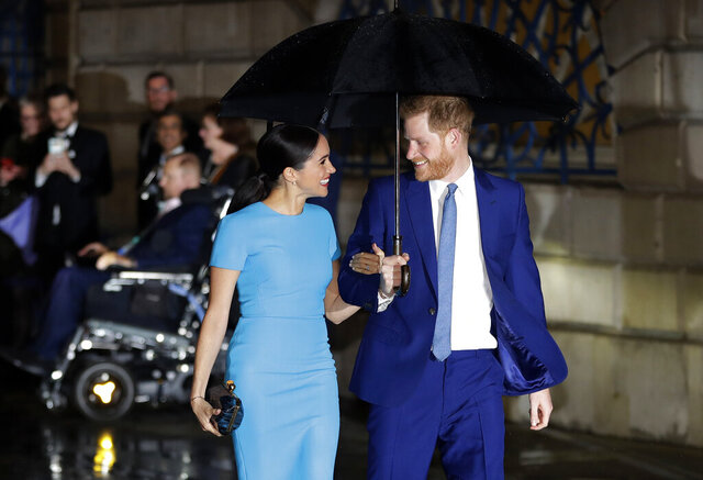 """FILE - In this Thursday, March 5, 2020 file photo, Britain's Prince Harry and Meghan, the Duke and Duchess of Sussex arrive at the annual Endeavour Fund Awards in London. Harper Collins U.K. announced Monday, May 4, 2020 that it will publish """"Finding Freedom: Harry and Meghan and the Making of a Modern Royal Family"""" in Britain and the Commonwealth on Aug. 11. The book will be published in the U.S. the same day by Dey Street Books. (AP Photo/Kirsty Wigglesworth, file)"""