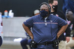 FILE - In this Nov. 8, 2020, file photo, Houston Texans head coach Romeo Crennel looks on during the first half of an NFL football game against the Jacksonville Jaguars in Jacksonville, Fla. There are only two general managers of color in the NFL. Of the 30 full-time coaches today, only four are minorities; both the interim coaches in Houston (Crennel) and Atlanta (Raheem Morris) are Black.(AP Photo/Gary McCullough, File)