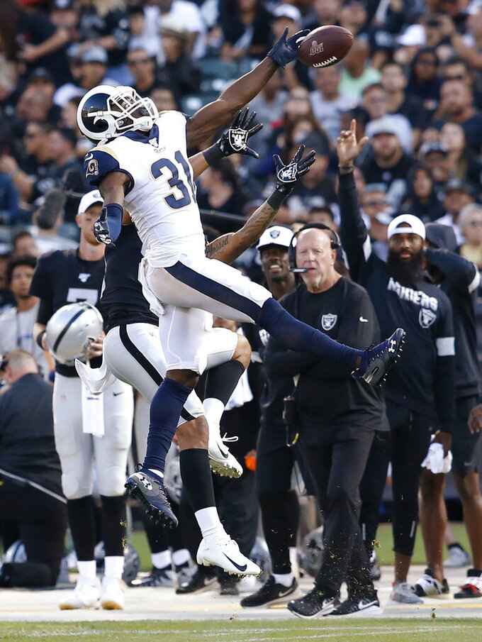 Los Angeles Rams' Darious Williams (31) deflects a pass intended for Oakland Raiders' Keelan Doss during the second half of a preseason NFL football game Saturday, Aug. 10, 2019, in Oakland, Calif. (AP Photo/Rich Pedroncelli)