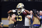New Orleans Saints wide receiver Michael Thomas (13) celebrates his touchdown reception in the first half of an NFL football game against the Indianapolis Colts in New Orleans, Monday, Dec. 16, 2019. (AP Photo/Bill Feig)