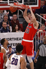 St. Francis' Deivydas Kuzavas (30) dunks during the first half against Robert Morris during an NCAA college basketball game for the Northeast Conference men's tournament championship in Pittsburgh, Tuesday, March 10, 2020. (AP Photo/Gene J. Puskar)