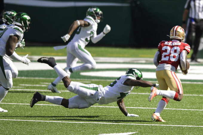 San Francisco 49ers running back Jerick McKinnon (28) runs past New York Jets' Neville Hewitt (46) for a touchdown during the second half of an NFL football game Sunday, Sept. 20, 2020, in East Rutherford, N.J. (AP Photo/Bill Kostroun)