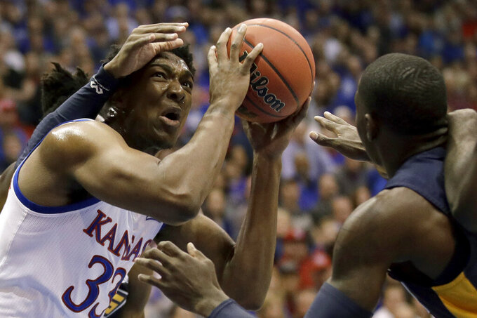 Kansas' David McCormack (33) shoots under pressure during the first half of the team's NCAA college basketball game against UNC Greensboro on Friday, Nov. 8, 2019, in Lawrence, Kan. (AP Photo/Charlie Riedel)