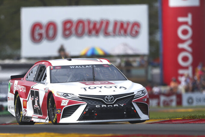 Bubba Wallace drives through the Bus Stop during a NASCAR Cup Series auto race in Watkins Glen, N.Y., on Sunday, Aug. 8, 2021. (AP Photo/Joshua Bessex)