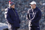 FILE - In this Jan. 10, 2012, file photo, New England Patriots head coach Bill Belichick, left, shares a laugh with Josh McDaniels during practice at the their training facility in Foxborough, Mass. While Belichick owns a record six Super Bowl championship rings, his former New England assistants have combined for one playoff victory as head coaches. (AP Photo/Winslow Townson, File)