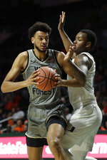 Wake Forest center Olivier Sarr, left, looks for an opening past Miami forward Keith Stone during the second half of an NCAA college basketball game, Saturday, Feb. 15, 2020, in Coral Gables, Fla. Miami defeated Wake Forest 71-54. (AP Photo/Wilfredo Lee)